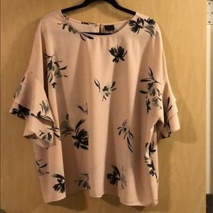 Pink and black plus sized blouse.